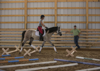 Marjorie riding Isabella in a Cavalletti clinic